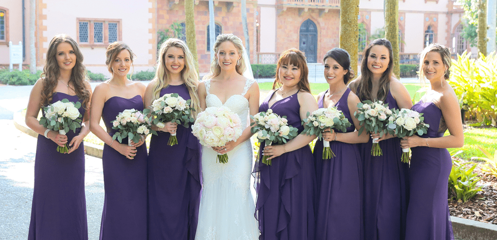 Bride and bridesmaids holding award-winning flower bouquets designed by Beneva Weddings in Sarasota, FL