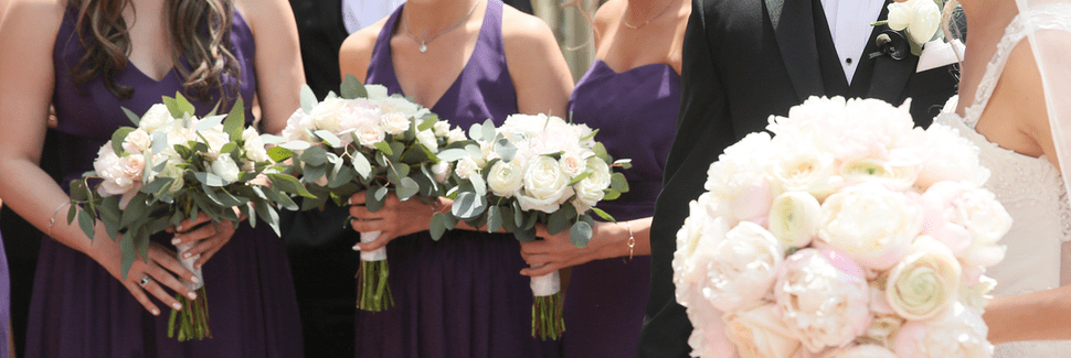 Bridesmaids holding bouquets with the bride and groom in a Sarasota wedding